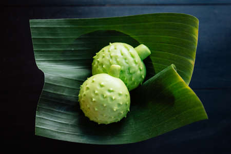 Durian buns in shape of durian served on banana leaf.
