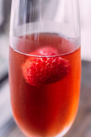 Close up Red cocktail with raspberry inside in glass wine. 写真素材