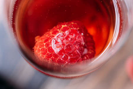 Close up Red cocktail with raspberry inside in glass wine. Stock Photo