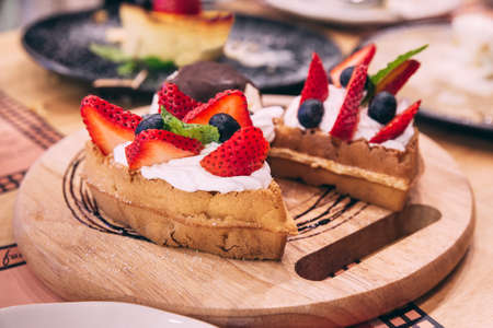 Waffles topping with slices of strawberry
