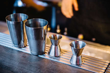 Stainless steel double-side cocktail jigger measure cup and shaker for making cocktails.