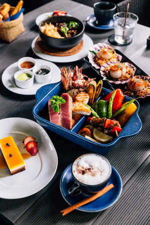 Seafood mixed grilled such as fish, squid, prawns, mussels and vegetables served with sweet and sour sauces.