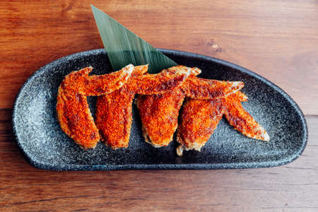 Top view of Chicken wings topping with chili powder served as appetizer.