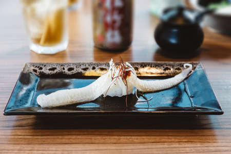Fish fin sushi Engawa sushi topping with saffron, traditional Japanese food.