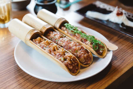Japanese bamboo rare marinated minced pork seasoned well and mixed with some herbs and vegetables giving it a very light and aromatic flavour. Banco de Imagens
