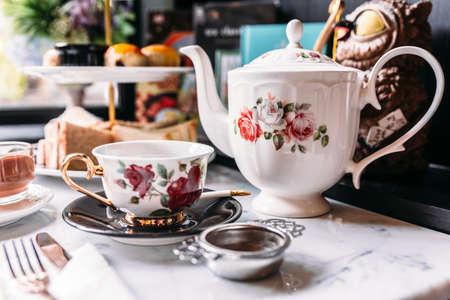 English Vintage Porcelain Roses Tea Sets including teapot, tea cup, plate, spoon and tea filter.