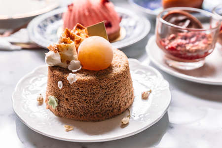 Fluffy sponge cake topping with coffee cream and ice sphere.