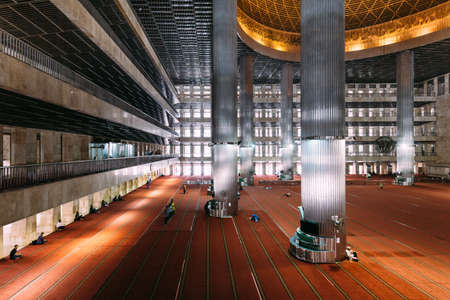 Masjid Istiqlal Interior with prayers in Indonesia is the largest mosque in Southeast Asia. Named Istiqlal, an Arabic word for independence Editorial