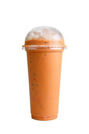 Isolated Front View of Iced Thai Tea in plastic cup with plastic cap. Studio shot.