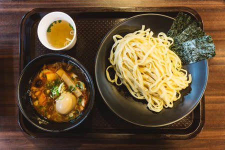 Tsukemen is a ramen dish in Japanese cuisine consisting of noodles which are eaten after being dipped in a separate bowl of soup or broth.