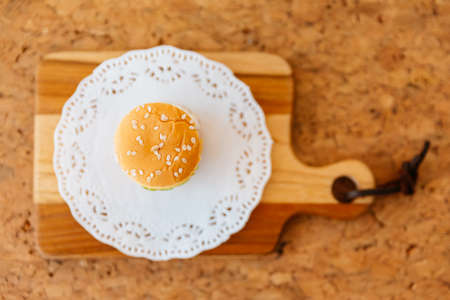 Top view of Mini Chicken Burger on wooden chopping board.