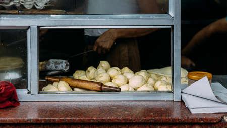 Preparing dough on kitchen counter for making Chicken Kati. Street food in Kolkata, India. Stockfoto