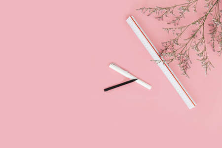 Pink color background with flower branches, scale ruler, pen and pencil on the right side. Architect and designer background with copy space. Standard-Bild - 121594410