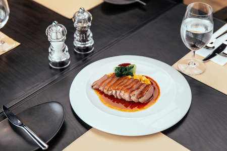 Roasted Duck Breast with cream of corn and tamarind poultry jus, Served with bread and butter. Standard-Bild - 121594420