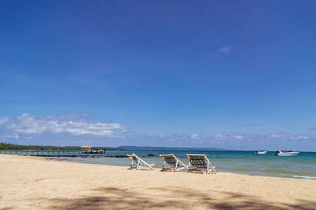 Three folding beach chairs on the beach with sea and bright sky in the background at Koh Mak in Trat, Thailand. Seasonal Vacation. Background with copy space. Standard-Bild - 123332476