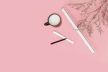 Pink color background with flower branches, scale ruler, a cup of milk, pen and pencil on the right side. Architect and designer background with copy space. Standard-Bild - 122493549