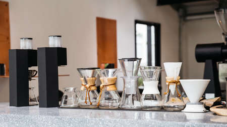 Coffee equipments with various sizes of drip coffee cups, drip paper and Espresso machine on marble top counter. Standard-Bild - 122494085