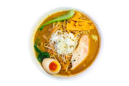 Isolated top view of Ramen Pork Bone Soup (Tonkotsu Ramen) with Chashu Pork, Scallion, Sprout, Carrot, Menma (Seasoned Bamboo Shoots), Dried Seaweed and boiled eggs. Standard-Bild - 122494082