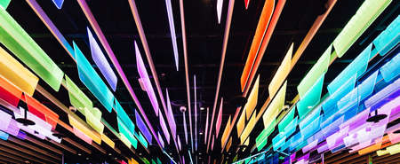 Rainbow colors transparent panels with LED lights that decorated with ceiling. Perspective background. Standard-Bild - 122494087