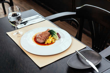 Roasted Duck Breast with cream of corn and tamarind poultry jus, Served with bread and butter. Standard-Bild - 122497366