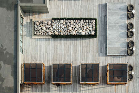 Top view of wooden floor rooftop with stone decorated and outdoor table set. Architectural Decoration, Outdoor Platform.