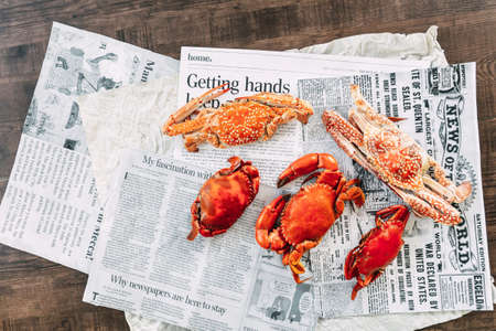 Top view Steamed Flower Crabs and Giant Mud Crabs on newspaper pages. Stok Fotoğraf