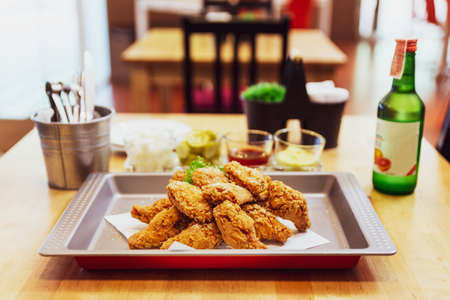Golden Crunchy Korean Fried Chicken (basic Huraideu-Chikin) served with pickled and Soju. In South Korea, fried chicken is consumed as a meal, an appetizer, Anju, or as an after-meal snack. Stok Fotoğraf