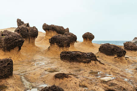 Yehliu Geopark with nobody, a cape on the north coast of Taiwan. A landscape of honeycomb and mushroom rocks eroded by the sea.