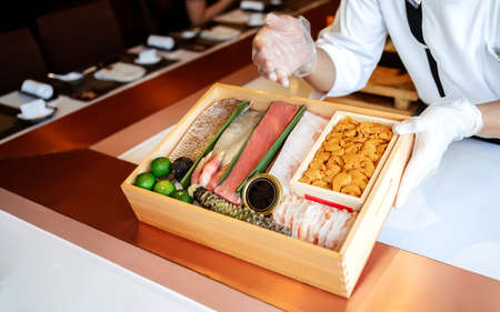 The chef presents the premium fresh ingredients in a wooden box before making the omakase meal such as Bluefin tuna (Toro and Chutoro), Uni, raw shrimps, truffle, wasabi and caviar.
