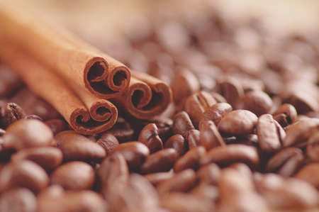 Aromatic roasted coffee beans and anis or badian background close up