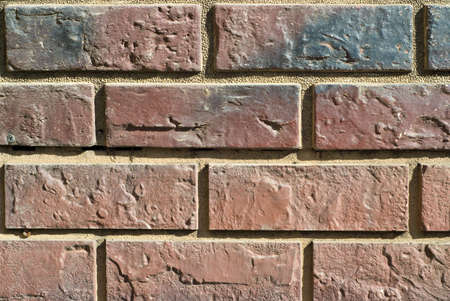section of an old brick wall. background texture