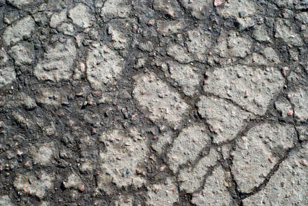 wet cracked asphalt surface. background texture Stock Photo