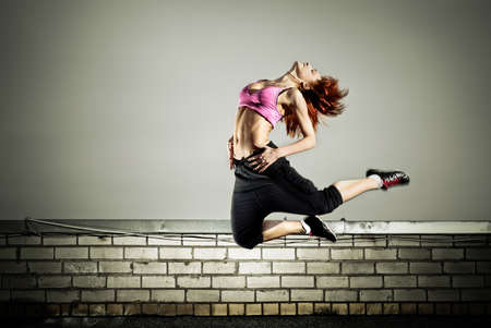 girl jumping on the roof Stock Photo