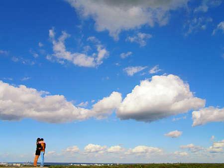 couple against blue sky photo
