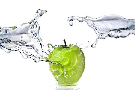 soda splash: perfect fresh water splash on green apple isolated on white