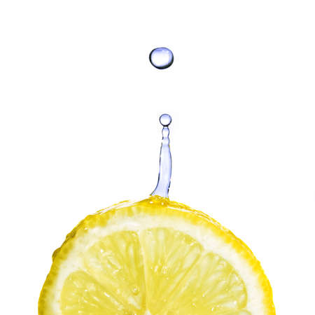 fallin: fresh water drop on lemon isolated on white
