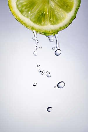 fallin: fresh water drops on lemon Stock Photo