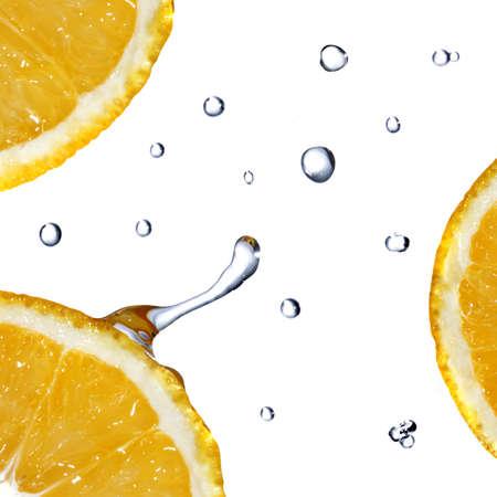 fallin: fresh water drops on orange isolated on white Stock Photo