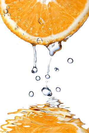 fallin: fresh water drops on grapefruit isolated on white