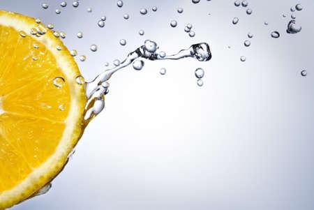 fallin: fresh water drops on orange Stock Photo