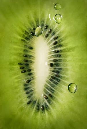 fallin: Macro of kiwi with water drops background Stock Photo