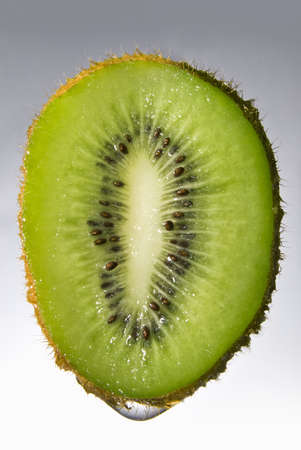 fallin: Close up kiwi with water drop Stock Photo