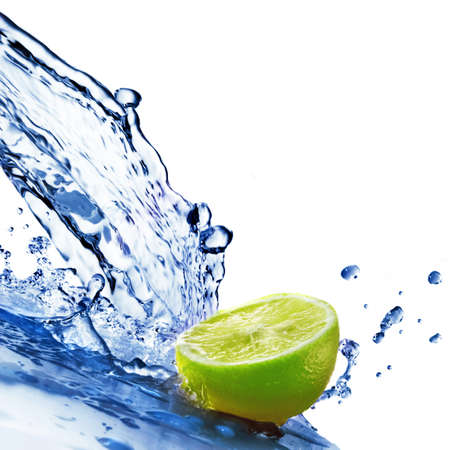 fallin: fresh water drops on lime isolated on white Stock Photo