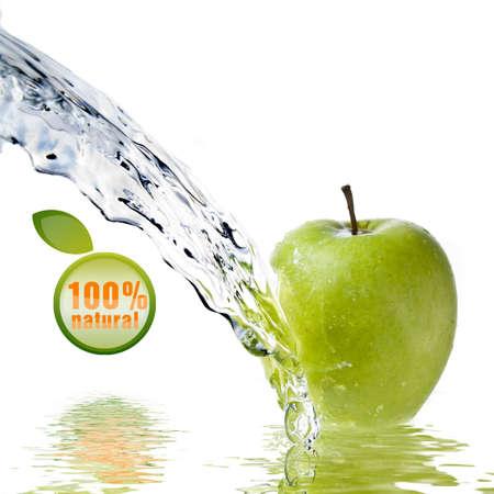 liquid summer: fresh water splash on green apple isolated on white