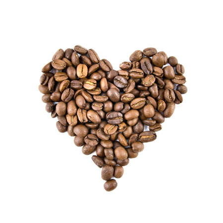 heart from coffee beans isolated on white photo