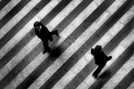 Busy crosswalk scene on the stripped floor photo
