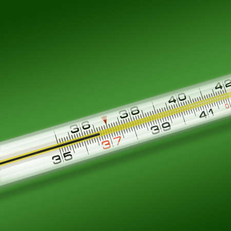close-up thermometer on green background photo