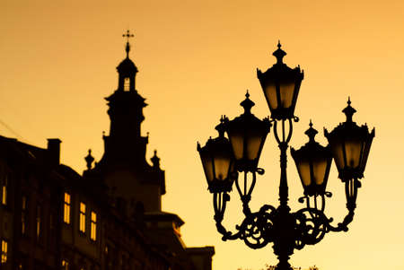 silhouettes of city lantern on the sunset Stock Photo