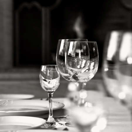 fire place: black and white photo of glass goblets on the table