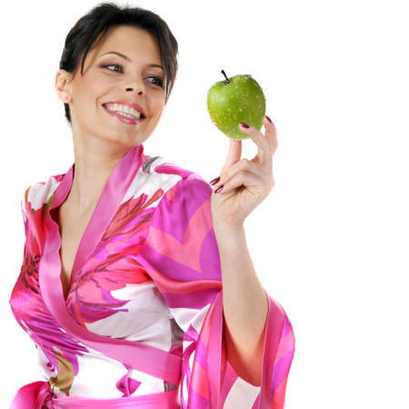 young beautiful happy woman holding green apple on white photo